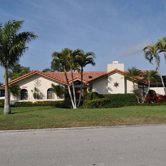 Brown Tile Roof on White House | Atlantis Roofing of Naples, Inc.