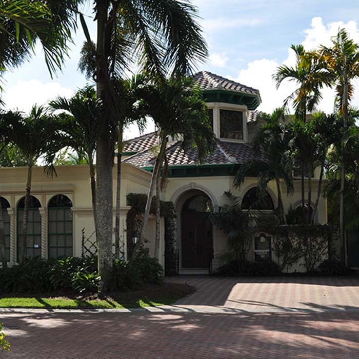 Home with Vines and Tile Roof | Atlantis Roofing of Naples, Inc.