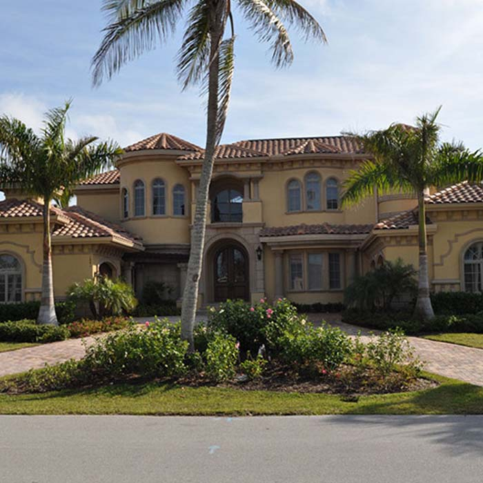 Tan Home with Brown Tiles | Atlantis Roofing of Naples, Inc.