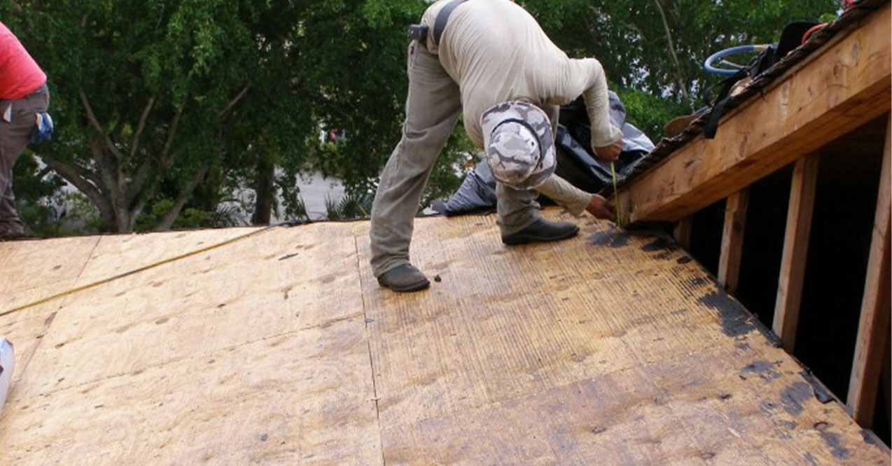 Contractor Doing a Tile Roof Replacement   Atlantis Roofing of Naples, Inc.